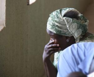 nigeria-sad-woman-in-church_nfbl